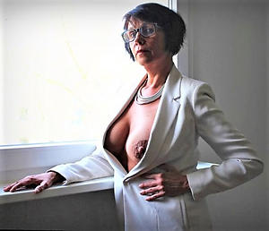 mature with glasses posing nude