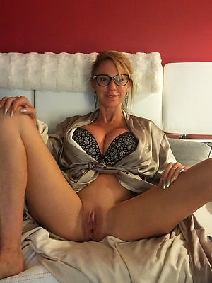women with glasses posing nude