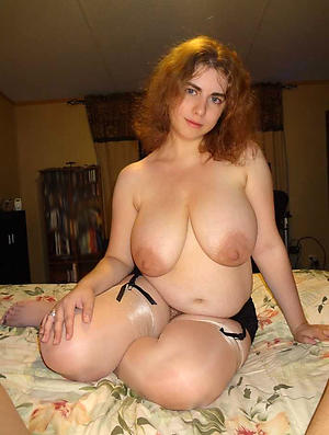 nice redhead granny stripping