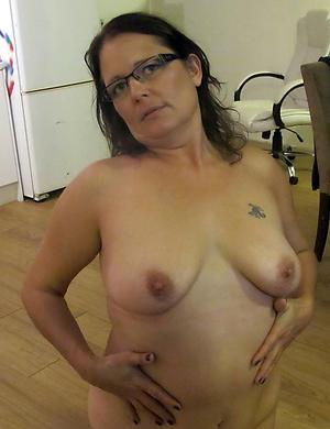 women with tattos love posing nude