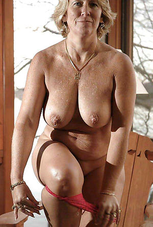 older blonde column posing undress