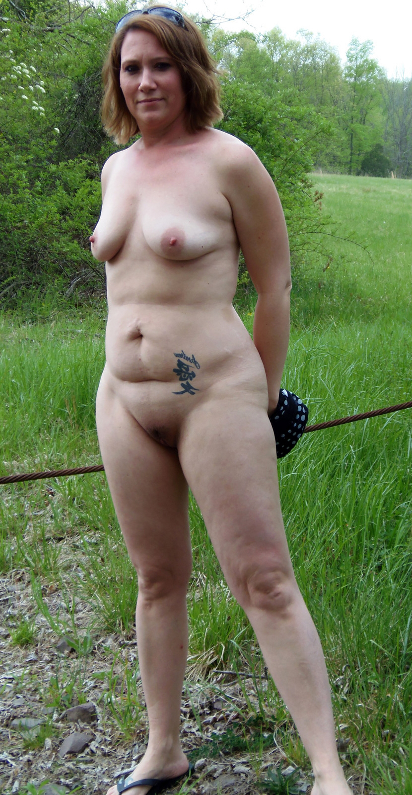 Tattos on battalion posing nude