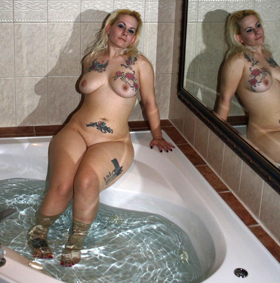 Naked women with tattos
